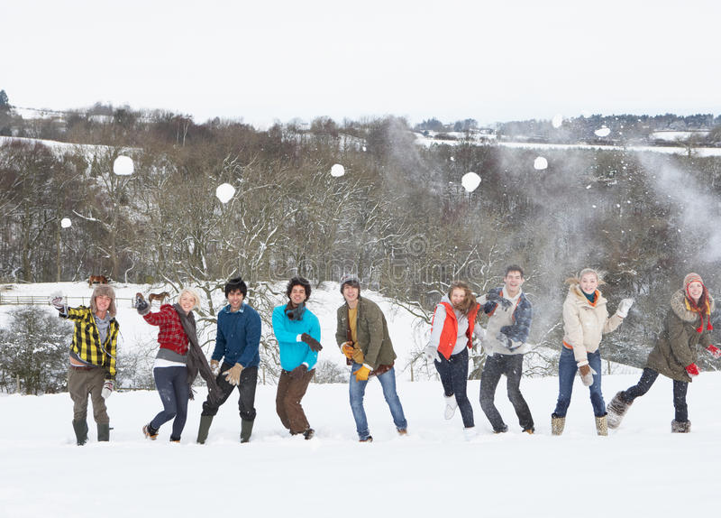 Teenage Friends Having Fun In Snowy Landscape royalty free stock photos