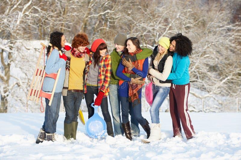 Teenage Friends Having Fun In Snowy Landscape stock image