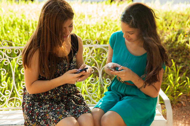 Teenage friends texting stock photography