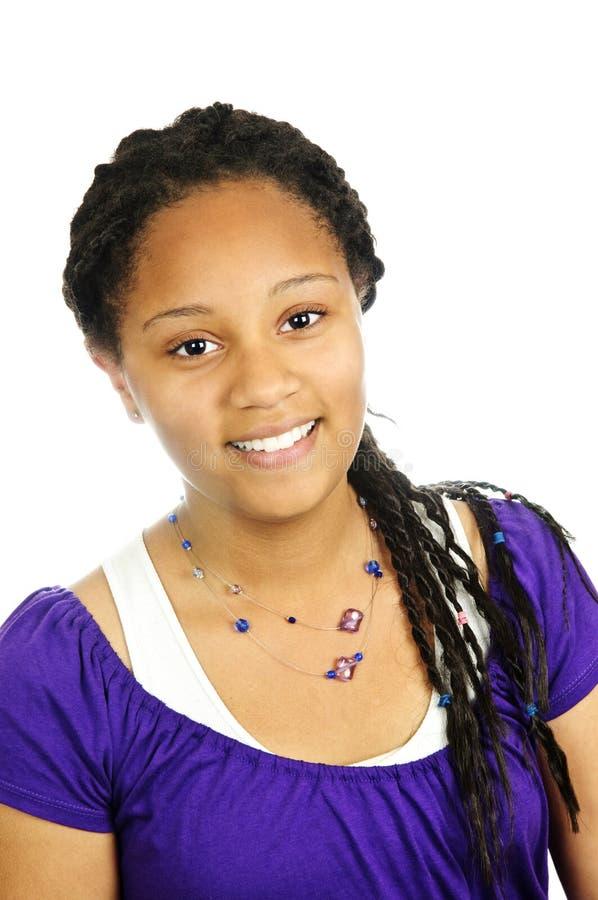 Teenage girl. Isolated portrait of beautiful black teenage girl royalty free stock image
