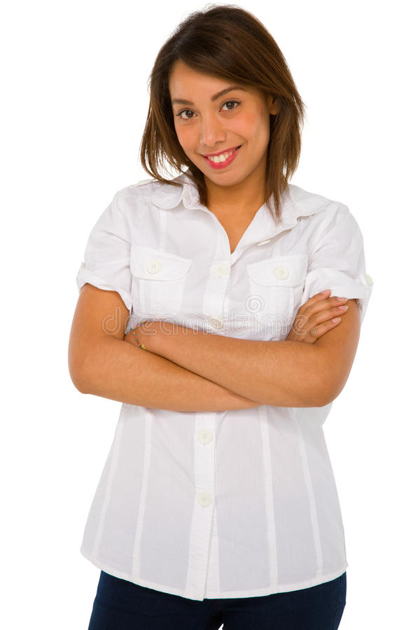 Teenage girl with arms folded. On white background stock photo