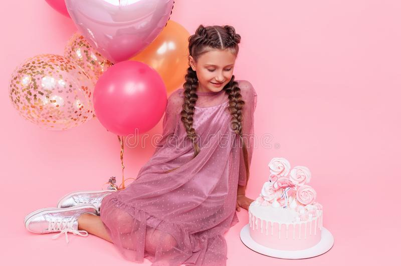 Awe Inspiring Teenage Girl With Balloons And A Birthday Cake Posing On A Pink Funny Birthday Cards Online Barepcheapnameinfo