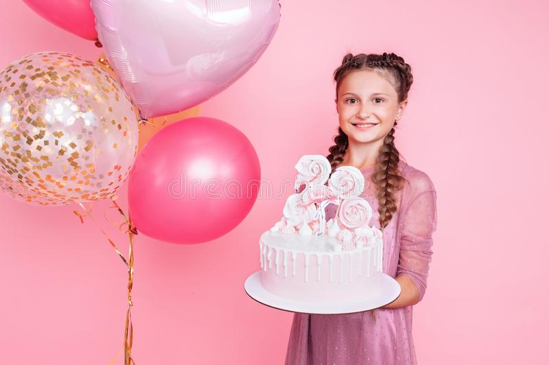 Astonishing A Teenage Girl With Balloons Holds A Cake In Her Hands On A Pink Funny Birthday Cards Online Aeocydamsfinfo