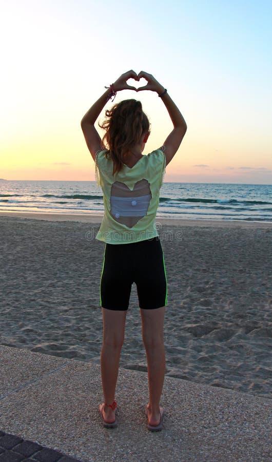 Teenage girl at the beach stock photo