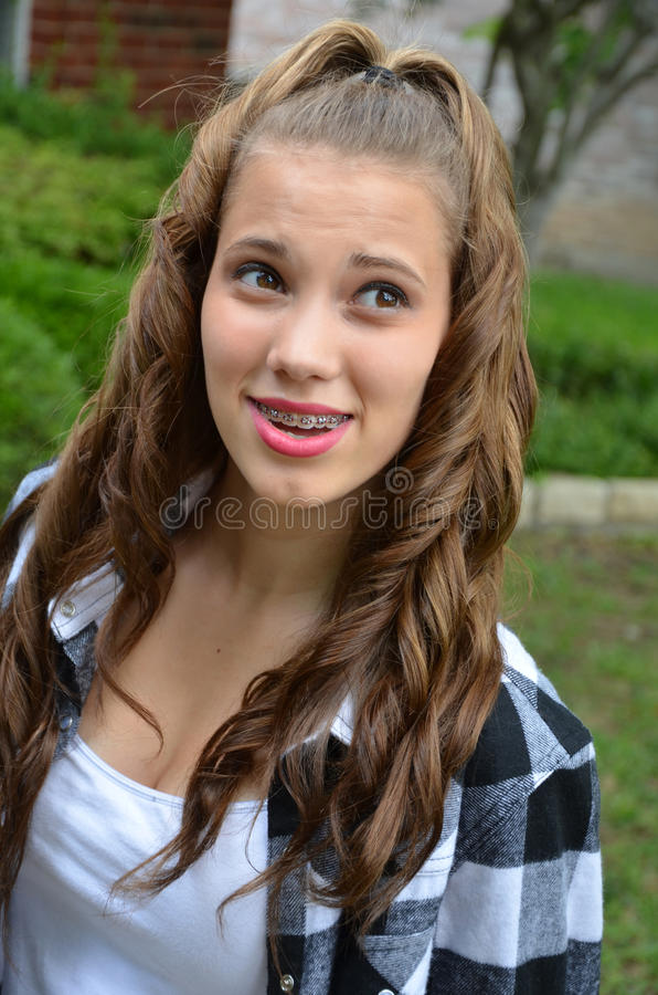 Teenage Girl. Beautiful Teenage girl with braces royalty free stock photo