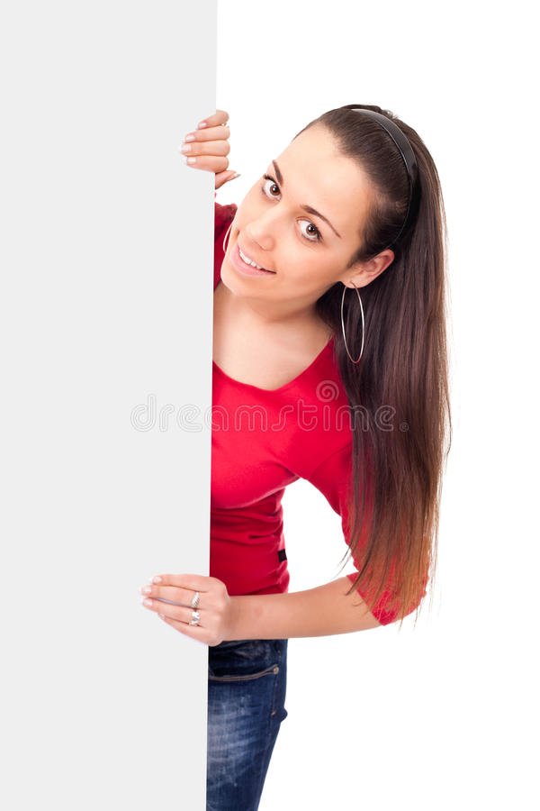 Teenage girl behind empty billboard stock photography