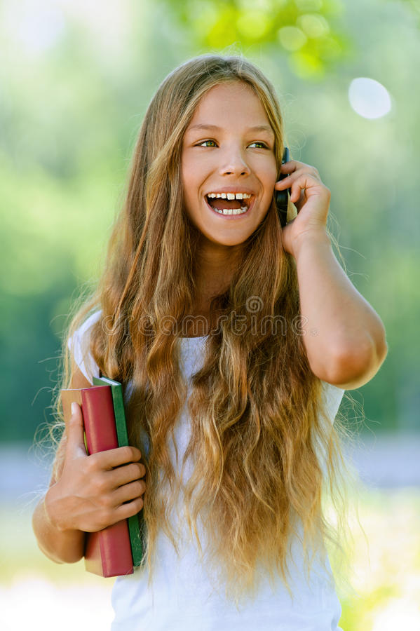 Teenage Girl With Books Talking On Royalty Free Stock Photo