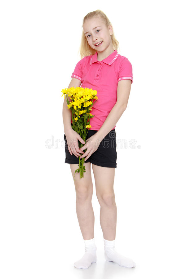 Teenage girl with a bouquet stock photo