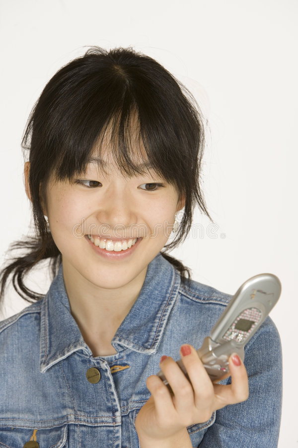 Teenage girl on cell phone. Model Release #302 Asian teenager on talking on cell phone royalty free stock images