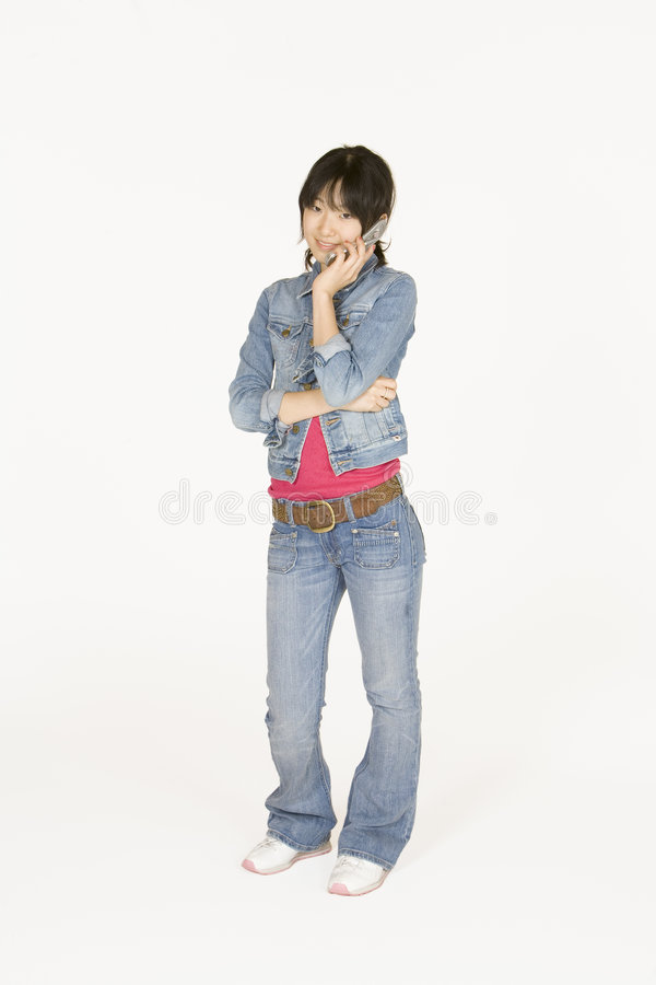 Teenage girl on cell phone. Model Release #302 Asian teenager on talking on cell phone stock photos