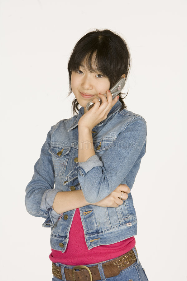 Teenage girl on cell phone. Model Release #302 Asian teenager on talking on cell phone stock images