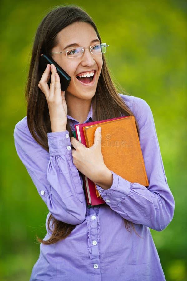 Teenage girl on cell phone says stock image