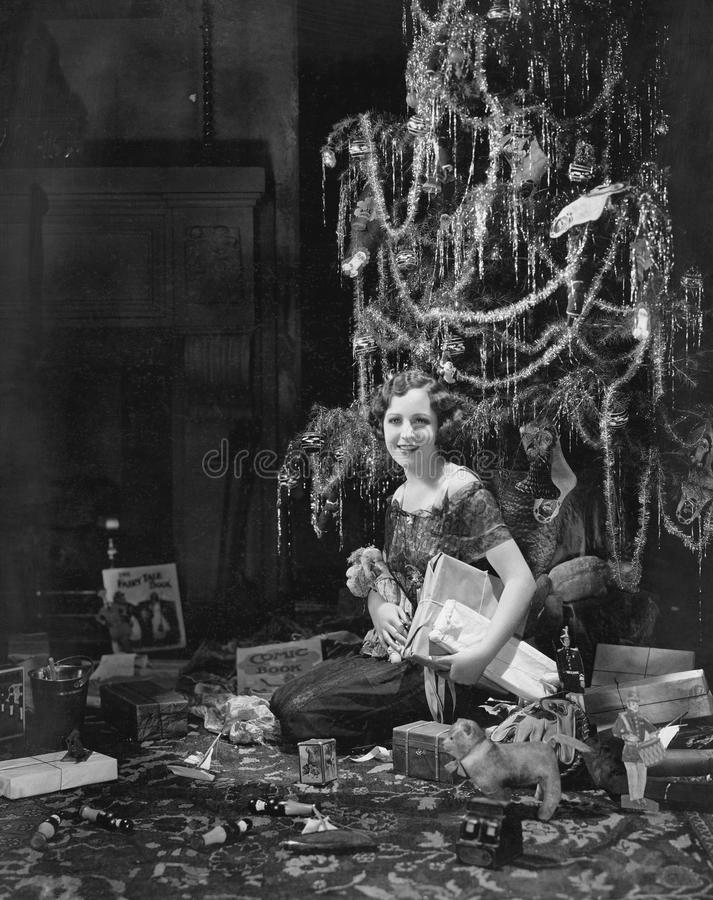 Teenage girl with Christmas presents. (All persons depicted are no longer living and no estate exists. Supplier grants that there will be no model release stock images