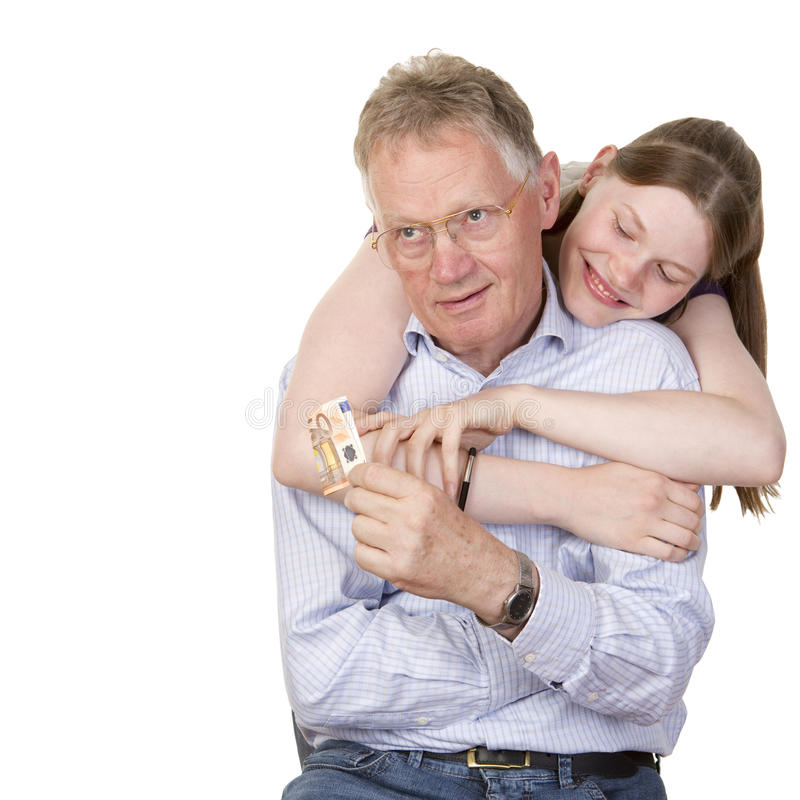 Teenage girl collecting her allowance. Cheerful teenage girl collecting her allowance money from her obviously nerved grandfather, isolated on white royalty free stock photos