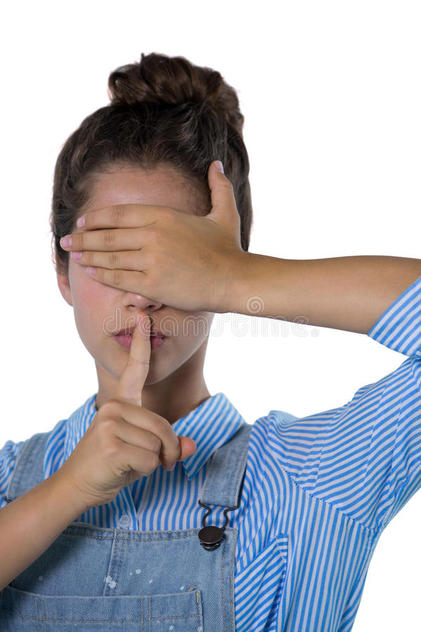 Teenage girl covering her eyes stock images