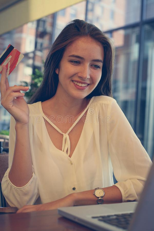 Teenage girl with credit card. Close up. Happy and smiling stock image
