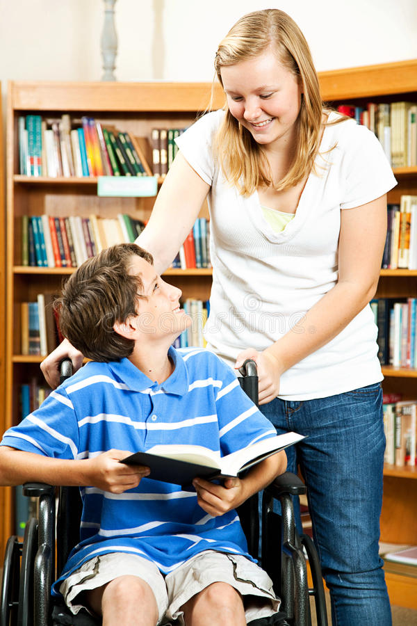 Teenage Girl And Disabled Boy Royalty Free Stock Photos
