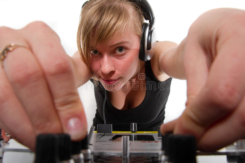 Teenage girl DJ adjusting sound levels. Teenager chick regulating sound on professional audio mixer stock photo