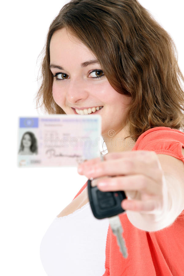 Teenage girl with driver license royalty free stock images