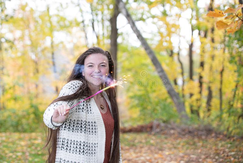 Teenage Girl Energetic with Sparkler royalty free stock photo