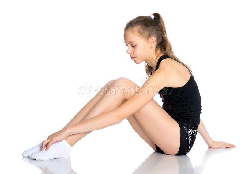 A teenage girl is engaged in fitness. stock photography