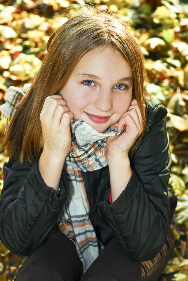 Teenage girl in the fall. Portrait of a beautiful teenage girl in fall park stock photos