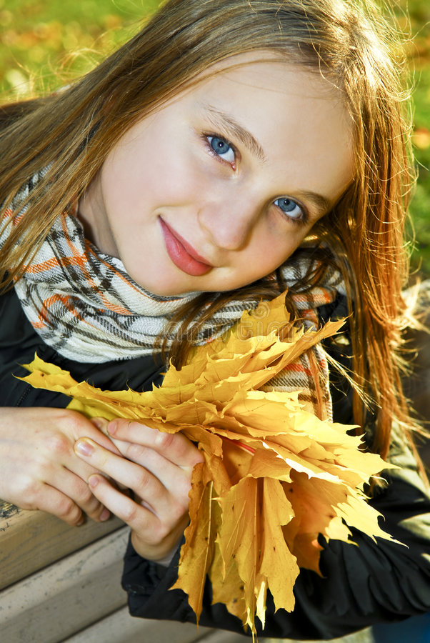 Teenage girl in the fall. Portrait of a beautiful teenage girl in fall park stock photography
