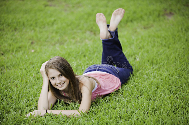 Teenage Girl Female on Grass stock images