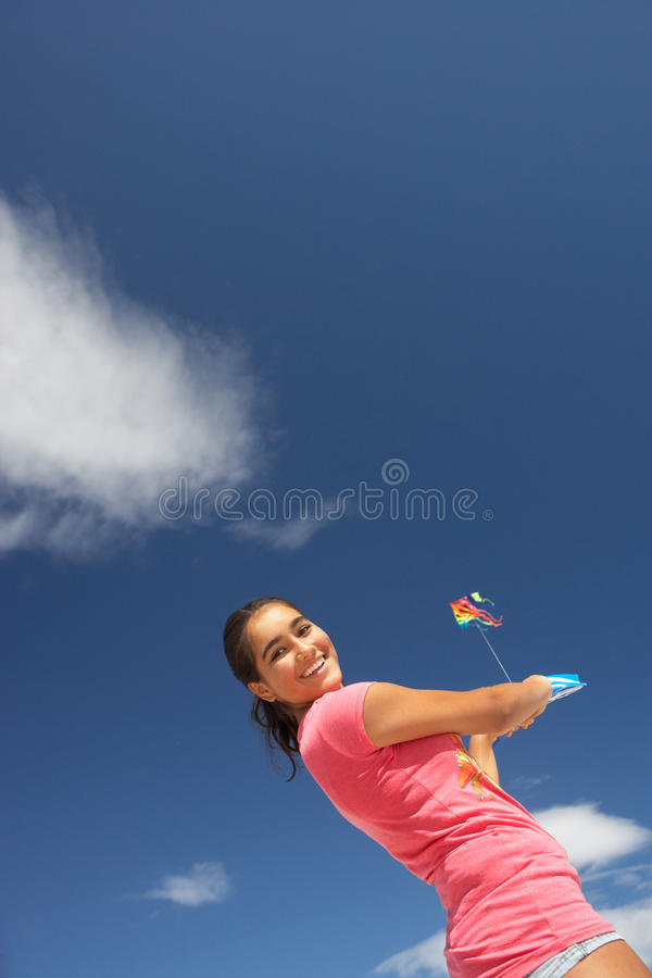 Free Teenage Girl Flying A Kite Stock Images - 21401724