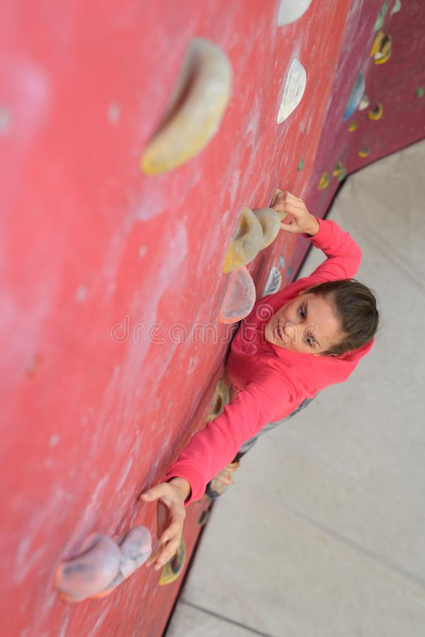 Teenage girl in free climbing wall royalty free stock images