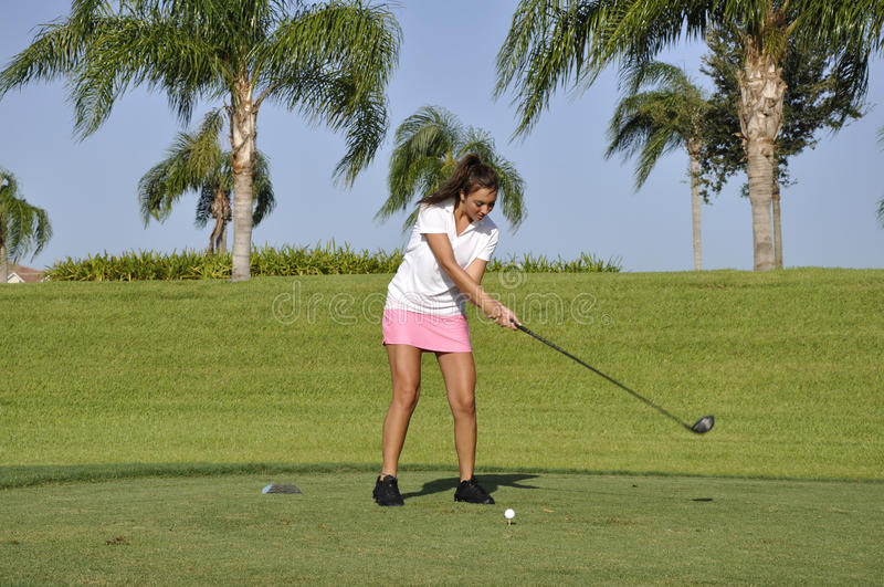 Teenage girl golfing royalty free stock images