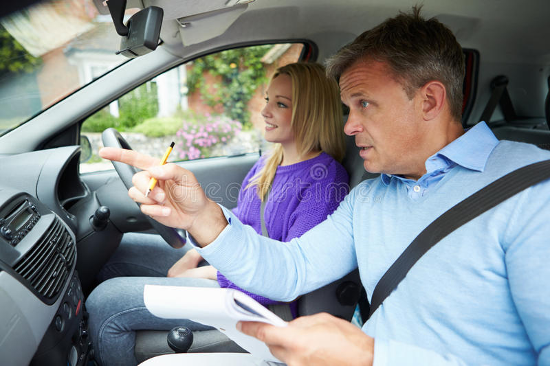Teenage Girl Having Driving Lesson With Instructor stock photography