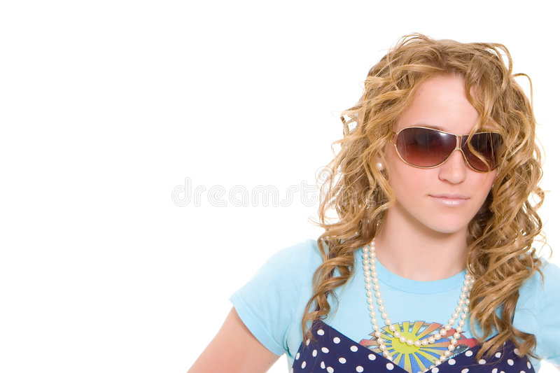 Teenage Girl Having Fun. Teenage Girl wearing sunglasses and showing attitude. Photo contains copy space royalty free stock photo
