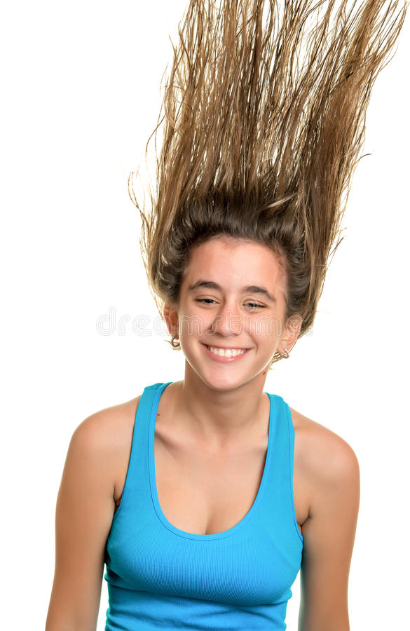 Teenage girl with her hair floating on the air. Happy teenage girl with her hair floating on the air - Isolated on white royalty free stock images