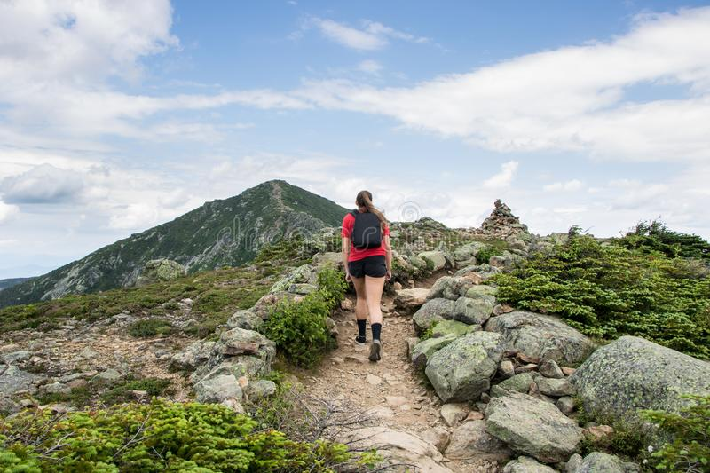 Teenage girl hiking on a beautiful mountain royalty free stock photos