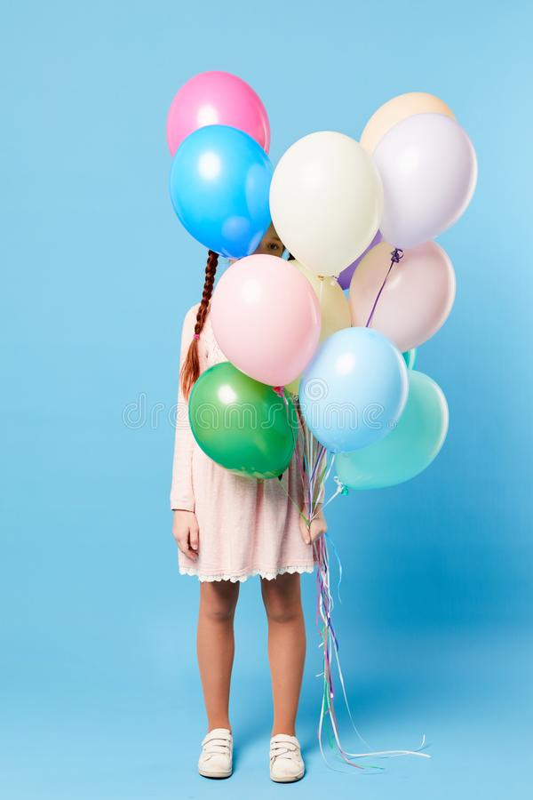 Teenage Girl Holding Balloons royalty free stock images