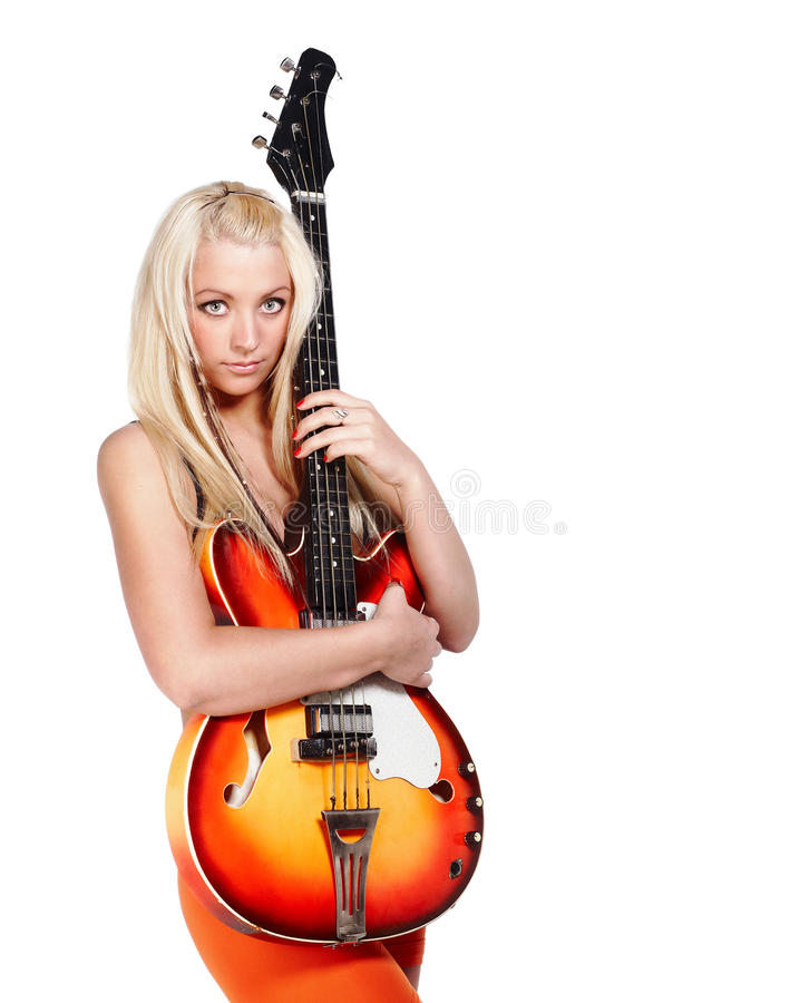Teenage girl holding a bass guitar with copy space royalty free stock images