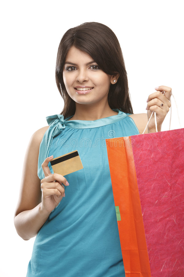 Teenage girl holding credit card stock photos