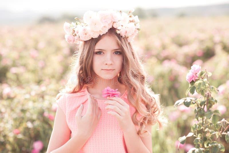 Teenage girl holding flower stock image