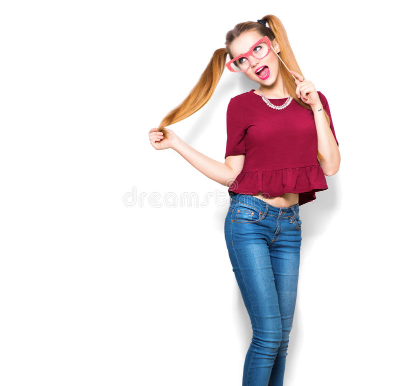 Teenage girl holding funny paper glasses on stick stock photography