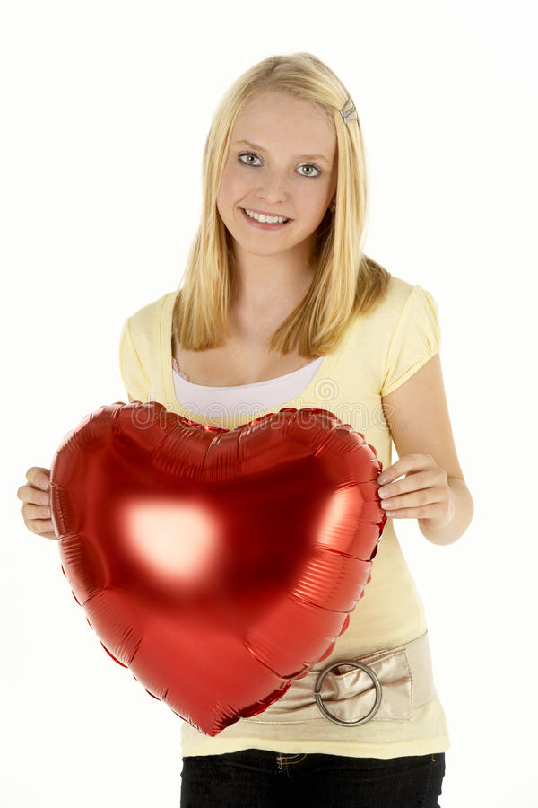 Teenage Girl Holding Heart-Shaped Balloon Royalty Free Stock Images