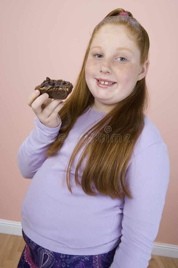 Teenage Girl Holding Pastry royalty free stock photos