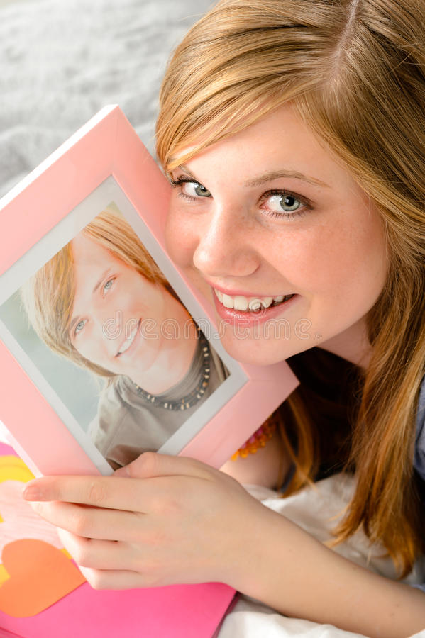 Download Teenage Girl Holding Picture Of Her Love Stock Photo - Image: 31025162