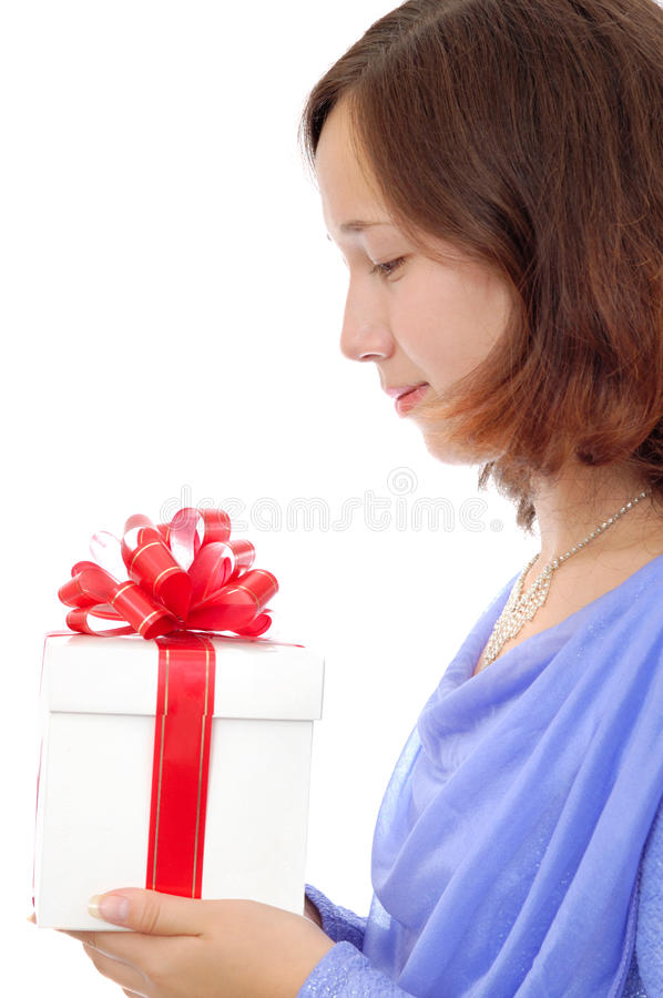 Teenage girl holding a present