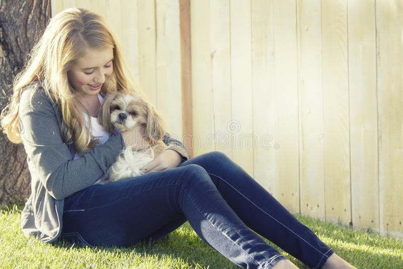 Teenage girl holding a small dog stock photos