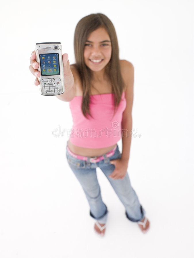 Download Teenage Girl Holding Up Cellular Phone Royalty Free Stock Photography - Image: 5945467
