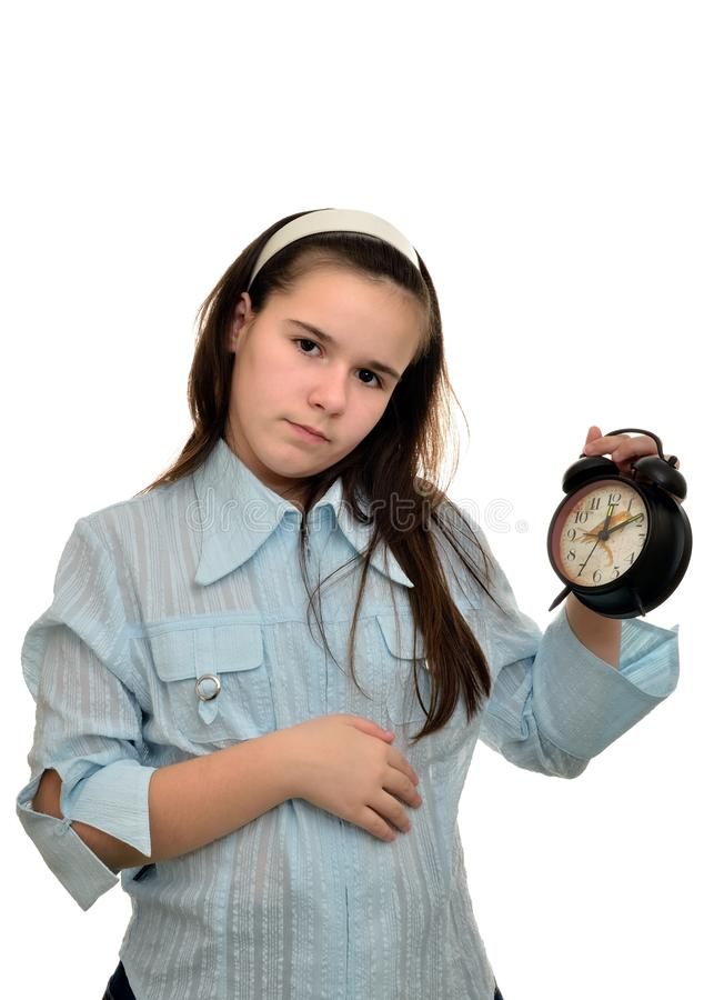 Teenage girl holds in his hand clock stock photography