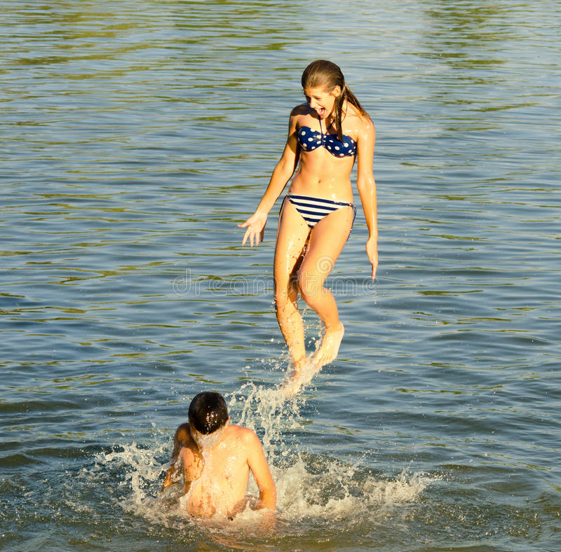Download Teenage Girl Jumping Into The River Stock Image - Image: 32659851