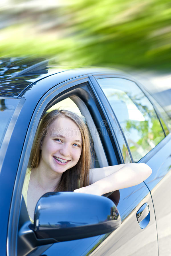 Download Teenage Girl Learning To Drive Stock Image - Image of proud, braces: 26070059
