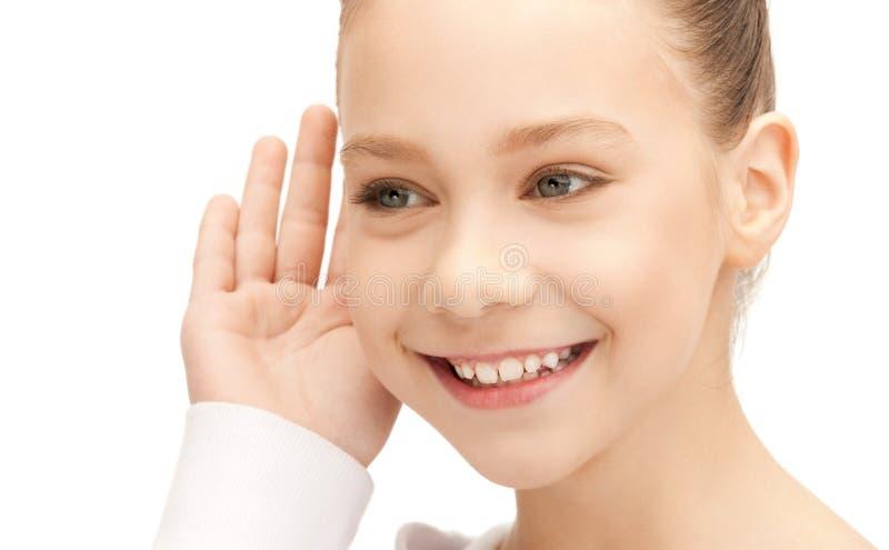 Teenage girl listening gossip royalty free stock photography